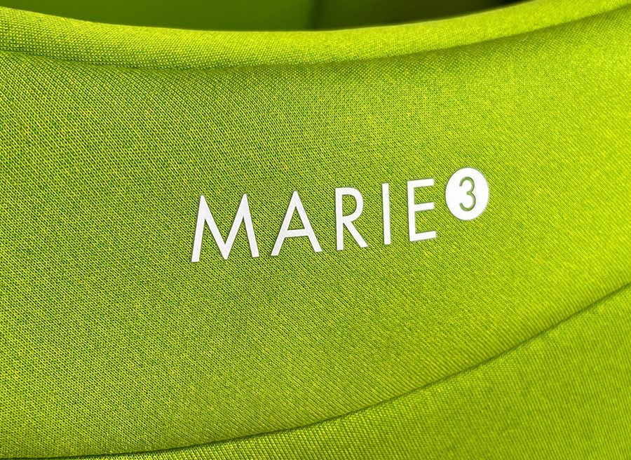 The latest generation of Swandoo's rotating car seat, Marie 3, in Lime Green